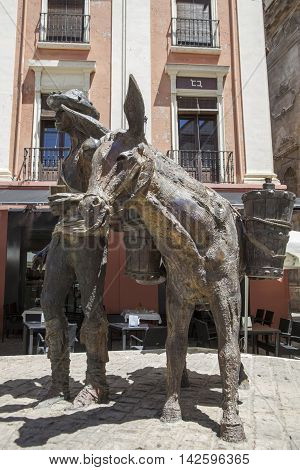 Granada Spain - August 5 2016: Sculptorical group to the driver of water at Plaza Romanilla Granada