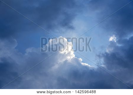 Deep blue sky, and dramatic clouds with sun light.