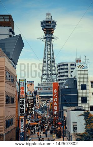 OSAKA, JAPAN - MAY 11: Tsutenkaku with street as famous landmark on May 11, 2013 in Osaka. With nearly 19 million inhabitants, Osaka is the second largest metropolitan area in Japan after Tokyo.