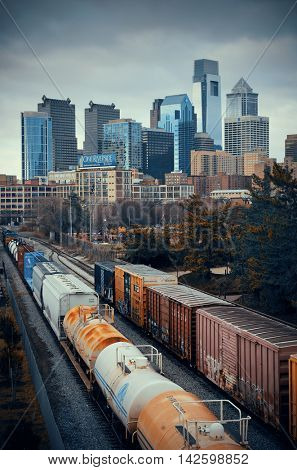 PHILADELPHIA, PENNSYLVANIA - MAR 26: city skyline with cargo train on March 26, 2015 in Philadelphia. It is the largest city in Pennsylvania and the fifth in the United States.