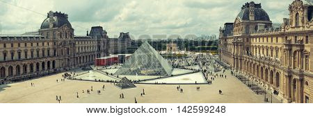 PARIS, FRANCE - MAY 13: Louvre panorama exterior view on May 13, 2015 in Paris. With over 60k sqM of exhibition space, Louvre is the biggest Museum in Paris.