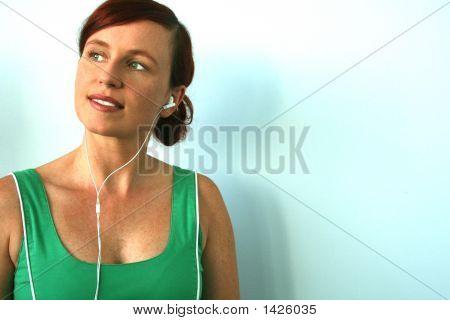 Woman Wearing Earphones