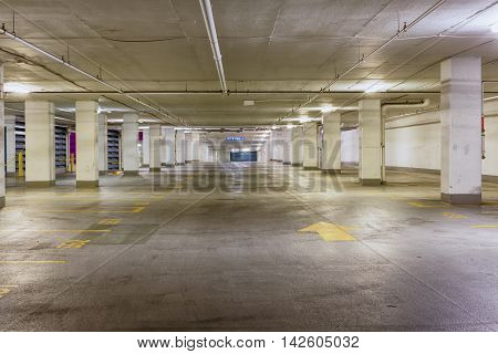 Entrance To A Grungy Empty Parking Area