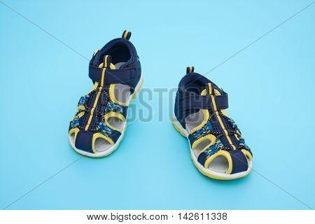 trendy sandal for boy on blue background