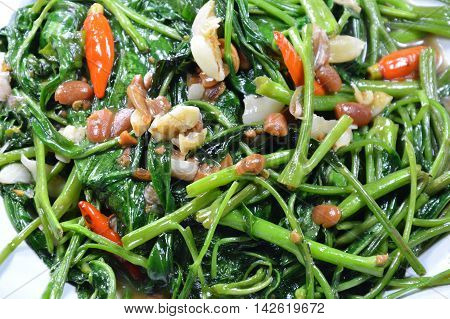 stir fried morning glory with soy bean paste and chili on dish