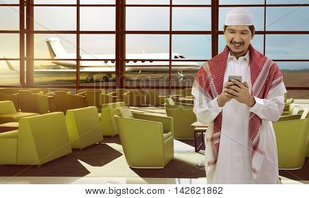 Young Man Asian Muslim Hold The Phone