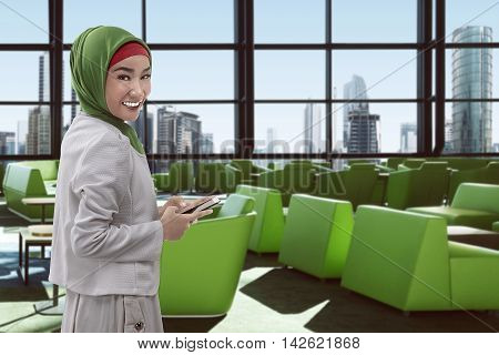 Young Asian Muslim Woman On The Airport