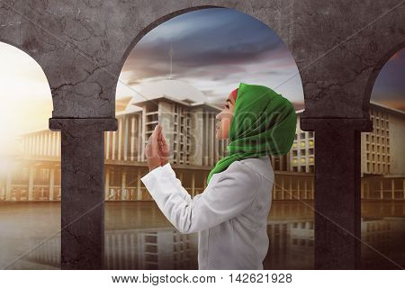 Young Asian Muslim Woman Praying To God