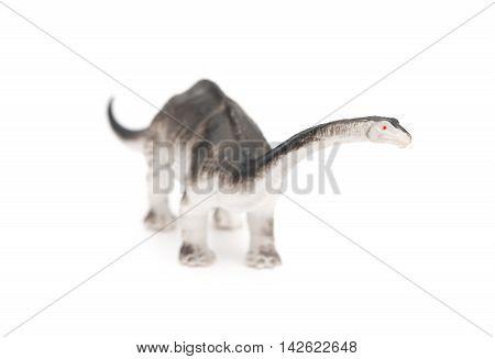 grey brachiosaurus toy on a white background