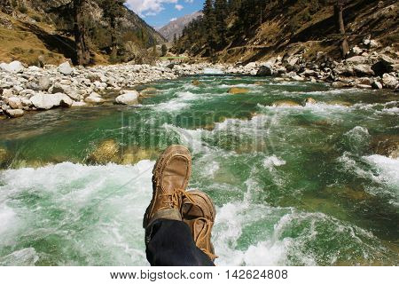 POV shot of a traveller on the bridge of a river