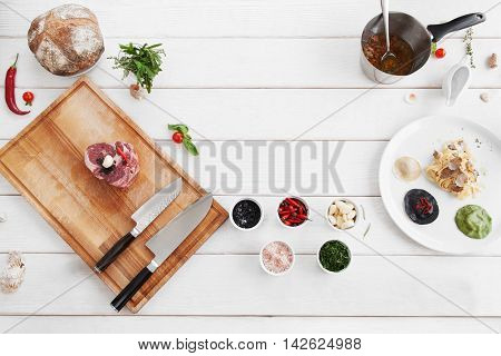 Ingredients for cooking, raw food, flat lay. Products for making mediterranean meal, white wooden background, copy space. Italian cuisine, culinary classes, restaurant kitchen concept