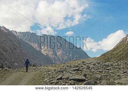 A man walking in the mountains alone in mahodand lake swat KPK Pakistan