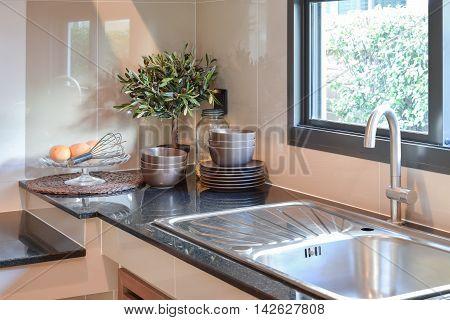 Ceramic kitchenware on the black granite counter top