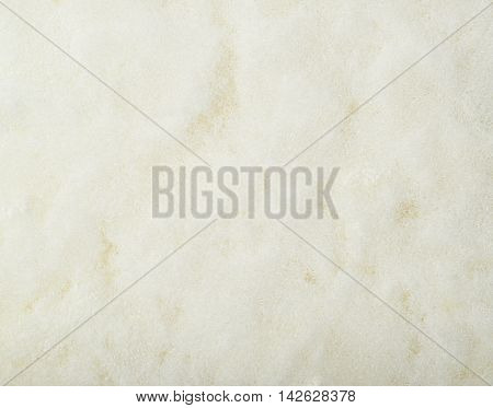 Close-up fragment of a kitchen sponge as a backdrop texture