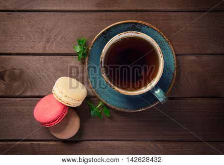 Colorful Macaroons With Cup Of Tea