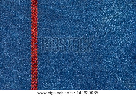 Denim fabric decorated with red rhinestones with space for text