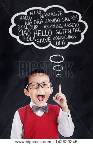 Portrait of a little boy learns foreign languages and speak in different languages