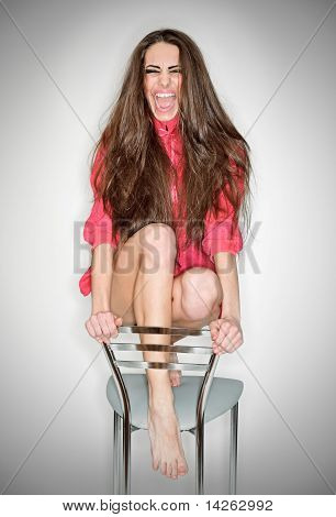 Screaming Aggressive Emotion Woman In Pink Blouse With Long Hairs, Ring Flash Studio Portrait On Whi