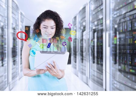 Portrait of Indian young woman using a digital tablet in the server room