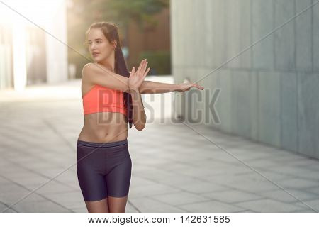 Smiling Fit Young Woman Doing Stretching Exercises