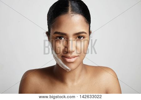 Closeup Portrait Of Woman With A Fase Cleansing Foam On The Cheek On White