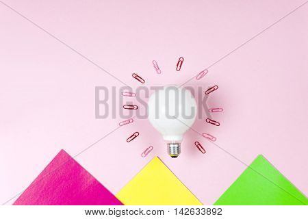 Great Idea Concept With Crumpled Colorful Paper And Light Bulb On Light Background. Creative Brainst