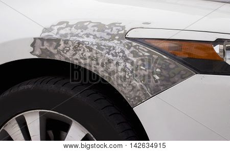 the body repair of a white car