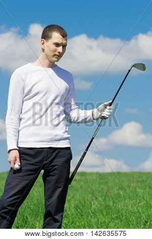 playing golf on grass, backdrop of the beautiful blue sky