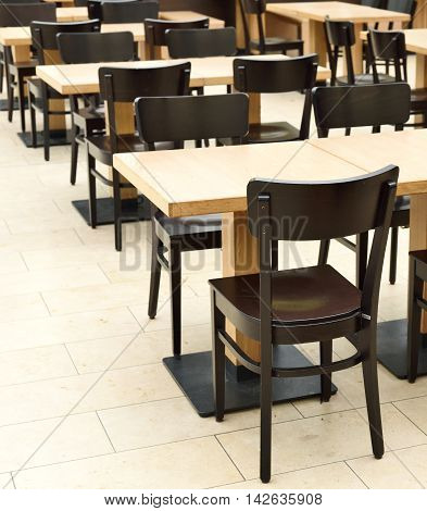 Restaurant furniture in an empty dining hall or restaurant.
