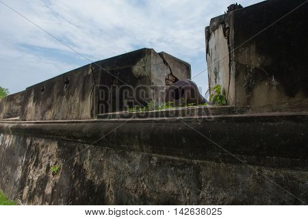 Dilapidated old fortress City walls. Thailand, background