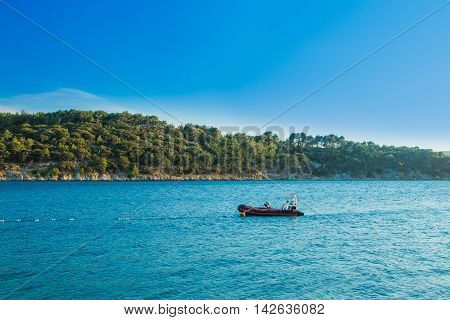 Recreation boat in blue lagoon, Cres Island in Croatia, seascape, sunny summer day