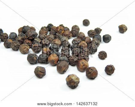 Black peppercorns, isolated on white background with copy space.