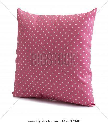Polka dot pink cushion isolated on white background