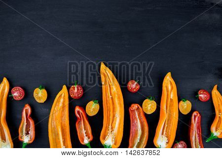 Mixed Of Half Red And Yellow Pepper With A Green Branch Near Cherry Tomato On  Black Backround. Top