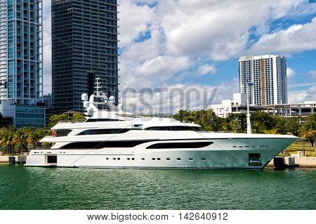 Downtown Miami along Biscayne Bay with condos and office buildings yacht docked in the bay