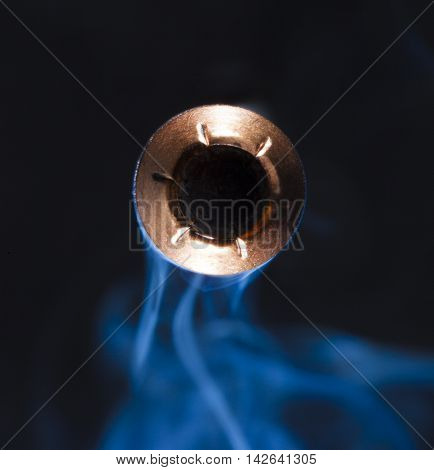 Bullet with a copper jacket and hollow point with smoke