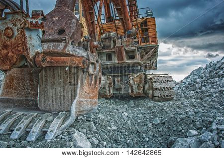 Excavator loads the factory gabbro, Russia, Ural