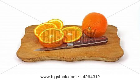 Slices Fresh Tangelo On Cutting Board