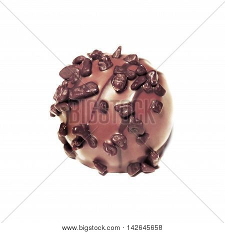 Chocolate truffle with dark chocolate, isolated on white.