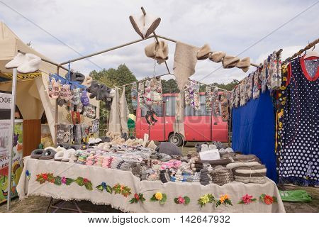Slavgorod, Belarus - August 14:fair Exhibition Of Handicrafts. Products Made Of Fur. Knitted Socks A