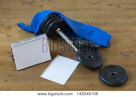 Equipment for sports and record results, on wood background