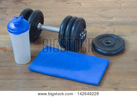 equipment for sport blue, on a wooden background floor