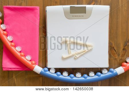 control weight gain during sports, on wood background