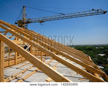 unidentifiable construction workers work on framing sunny day