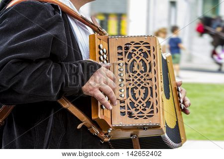 SELARGIUS, ITALY - September 13, 2015: Former marriage Selargino - Sardinia - detail of an accordion with keyboard buttons