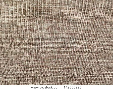 Closeup surface abstract fabric pattern at the brown fabric carpet at the sofa textured background