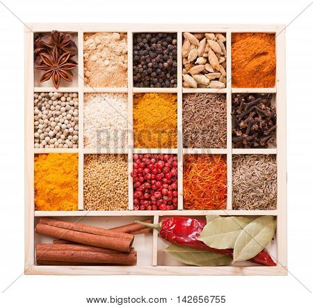 Assorted spices in the wooden box isolated on white background