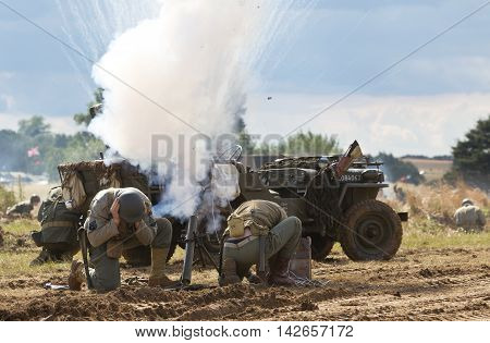 WESTERNHANGER, UK - JULY 25: Reenactors fire simulated mortar rounds towards the German army at the height of a WW2 battle re-enactment at the War & Peace show on July 25, 2015 in Westernhanger