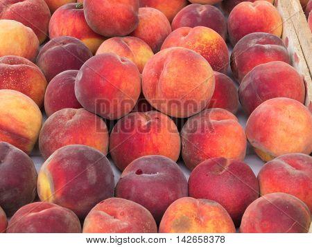 Fresh organic peaches at a farmers market
