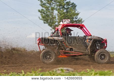 ARNCOTT, UK - MAY 4: An unnamed driver competing in the UK SXS RZR series takes one of the tight right hand corners at speed on May 4, 2014 in Arncott